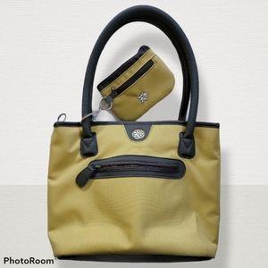 NWOT yellow and brown Sherpani purse